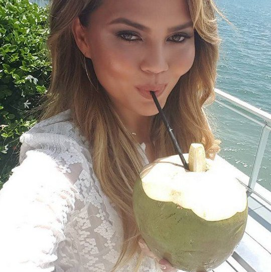 Chrissy-Tiegan-drinking-coconut-water.jpg